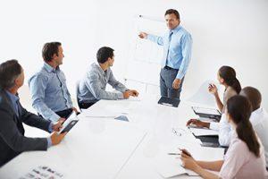 Business man explaining graph