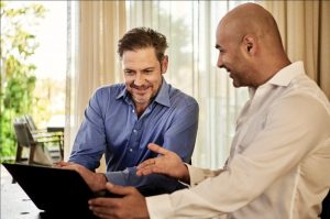 A sales executive talking to a client