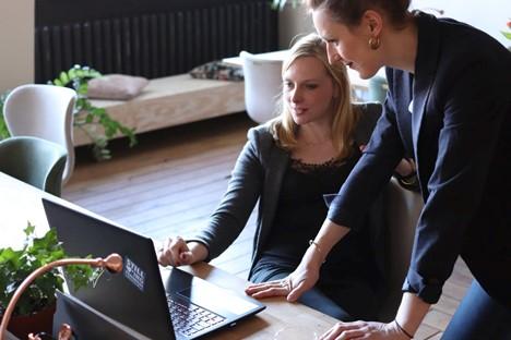 A top executive explaining job details to an executive assistant
